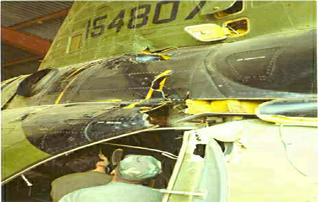 Friendly fire damage to aft pylon, H-46, during night medevac